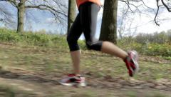 woman running over meadow close - stock footage