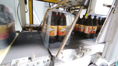Beer bottles moving on packaging line in Ochakovo factory Stock Footage