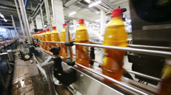 Bottles with light beer moving on conveyor in Ochakovo factory Stock Footage