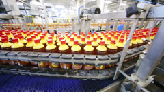 Top view of conveyor with bottles with fresh light beer Stock Footage