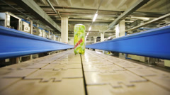 One green mojito can moving on conveyor in Ochakovo factory Stock Footage