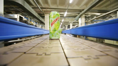 Green mojito cans moving on conveyor in Ochakovo factory Stock Footage