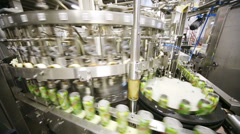 Conveyer line of filling and packing metallic cans with mojito - stock footage