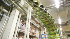 Wet empty cans of mojito moving on conveyer Stock Footage