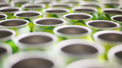 Many empty aluminum cans for drinks move on conveyor, close-up - stock footage