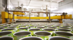 Working conveyer line with empty metallic cans in modern brewery - stock footage