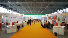People walking between stands at 12th Russian Exhibition Stock Footage
