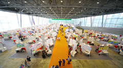 Stands area with visitors at 12th Russian Exhibition Stock Footage