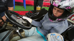 Boy in kart preparing to start the lap on carting course Stock Footage