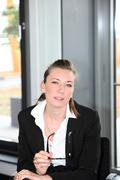 serious smart young businesswoman - stock photo