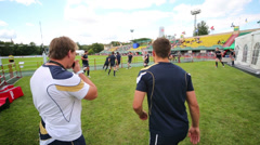 Coach supervising team training at Europe Championship - stock footage