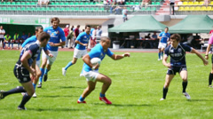 Strong players of rugby on green field at  Europe Championship - stock footage