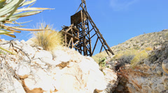 Pan of Standard Mine Head 1 and Mine in the Mojave Desert Stock Footage