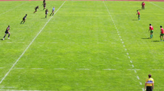 Rugby match with player kicking the ball Stock Footage