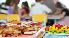 Sandwiches with sausage and vegetables with a blurred background Stock Footage