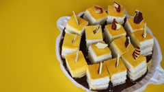Kind of delicious sliced ??yellow cake on a yellow table Stock Footage