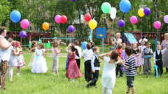 Children with balloons in kindergarten 1042 at party - stock footage