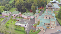 Trinity church in park with houses during the day, aerial view Stock Footage