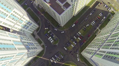 Big parking lot between buildings with many cars during the day Stock Footage