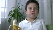 Stock Video Footage of Child eating banana 2