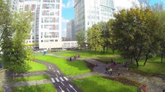 Parents with baby carriages in park near block, above view Stock Footage