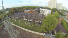 Power station in neighborhood in big city, above view Stock Footage