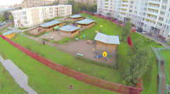 Big kindergarten with playgrounds near living complex Stock Footage