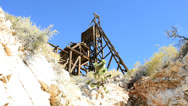 Stock Video Footage of Pan of Standard Mine Head 1 and Mine in the Mojave Desert