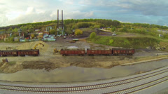 Excavator unloads gravel from cargo wagon Stock Footage