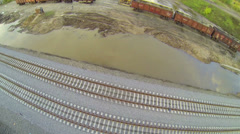 Top view of railway track near cargo wagon unload station Stock Footage