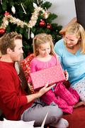 Christmas: family opening christmas presents Stock Photos