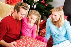 Christmas: family opening christmas presents Stock Photos