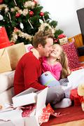 christmas: girl thanks father for gift - stock photo