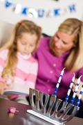 hanukkah:  focus on menorah and dreidel - stock photo