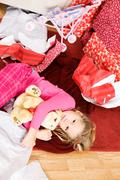 Stock Photo of christmas: girl lying on floor in wrapping paper