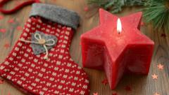 Christmas candle in star form is lit with a match. Stock Footage
