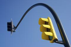 Yellow traffic light Stock Photos