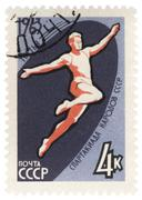 long jumper on post stamp - stock photo