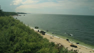 Stock Video Footage of View of rocky/sandy coastline (1 of 2)