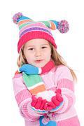 Winter: little girl holding snow Stock Photos
