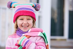 Stock Photo of winter: laughing girl in winter clothing
