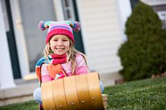 Winter: little girl ready for snow Stock Photos