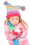 winter: winter girl blowing snow - stock photo