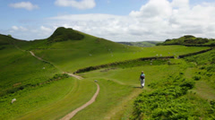 Woman Walking Through Scenic British Countryside Stock Footage