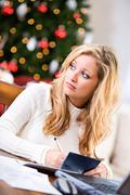 Christmas: upset woman paying christmas bills Stock Photos