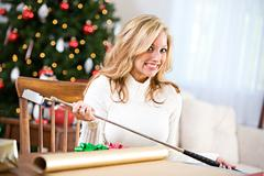 Stock Photo of christmas: not sure how to wrap golf club