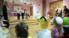 Parents day in kindergarten with performance on the theatre stage Stock Footage