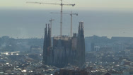 Stock Video Footage of Skyline of Spain Catalonia Barcelona Sagrada Familia cathedral w scaffolds