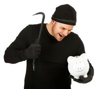 burglar: evil man breaks bank - stock photo