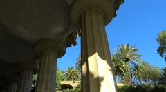 Stock Video Footage of Pan Spain Catalonia Barcelona Park Parc Guell column n Palm tree